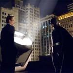 Det. Sgt. Gordon and Batman meet up after the batsignal is lit up.