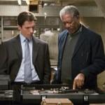 Wayne Enterprises employee Lucius Fox helps Bruce Wayne get his equipment ready