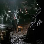 Bruce Wayne explores the caves adjacent to Wayne manor