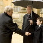 Alfred and Bruce greet all of the guests that attend the late Waynes' funeral