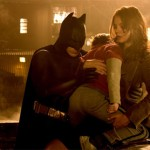 Batman and Rachel save a child from the chaos