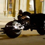 Batman uses his modern motorcycle to catch up with the villains