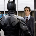 Bruce Wayne looks at the improved batsuit