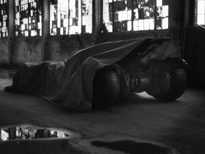 "Batman's ride will soon be revealed by Zack Snyder via Twitter. The Justice League director posted a picture today that showed a car with a large tarp covering all of it — except for a small portion of the back wheels. The tweet stated: ""Could be time to pull the tarp…Tomorrow?"" It's assumed the car […]"